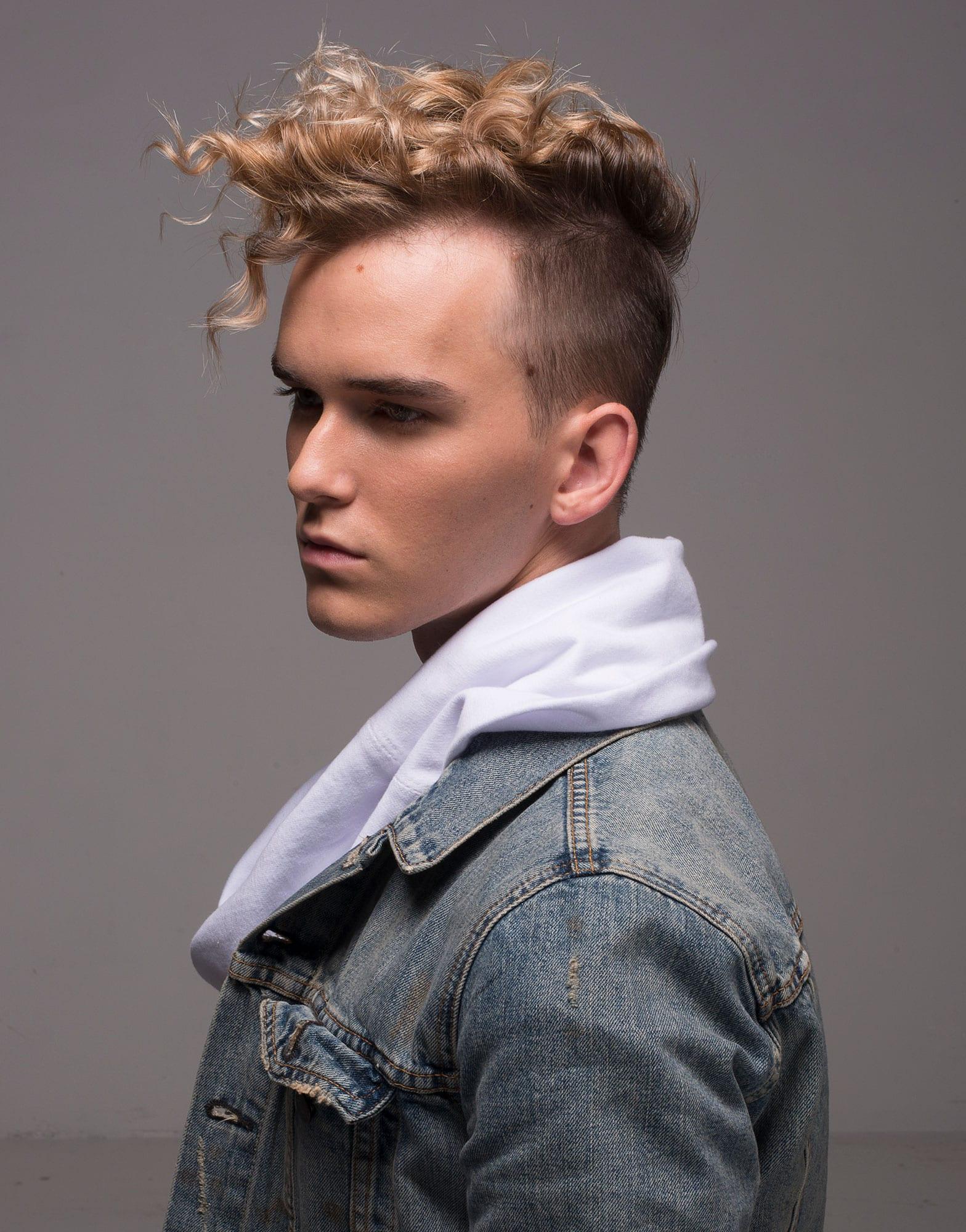 A man after getting his hair cut at a hair salon in Denver, CO